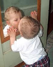 baby boy kissing self in mirror