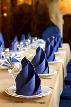 table set with blue napkins