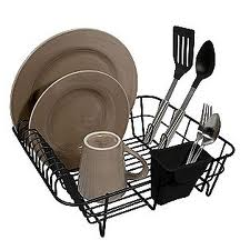 dish drainer with dishes and flatware