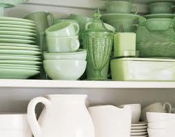 green and white dishware in a cupboard