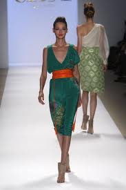 model wearing green dress with orange belt
