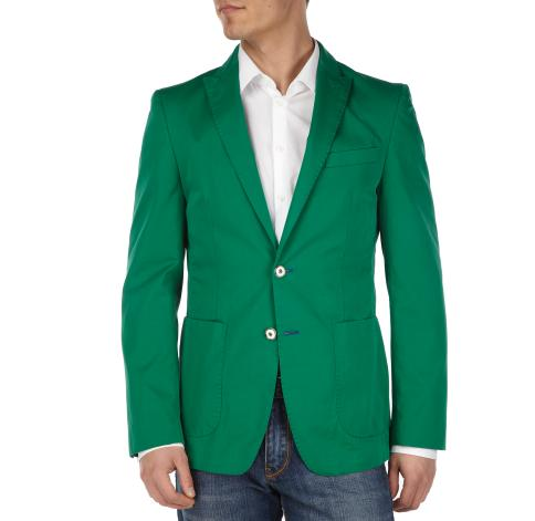 man wearing jeans, a white shirt and a green sportcoat